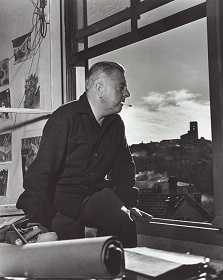 Jacques Prevert sitting at a window Vence 1953